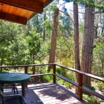 deck with seating and forest view