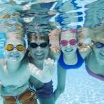 family having fun in the pool