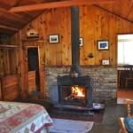 cabin interior, bedroom, fireplace