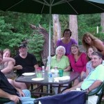 family happy at picnic table