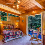 bedroom with adjoining deck